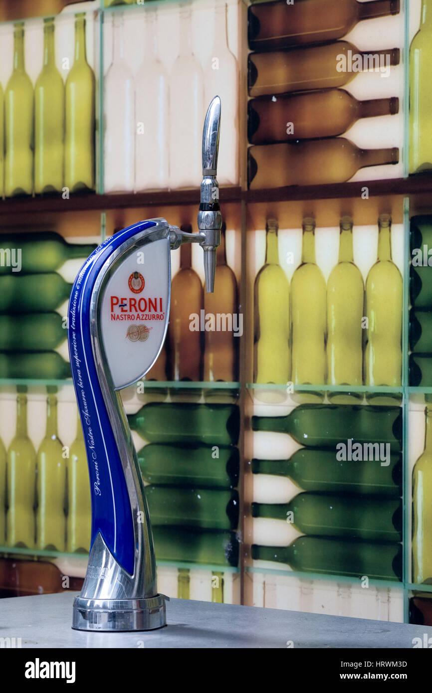 Draft beer dispenser and wine bottles - Stock Image