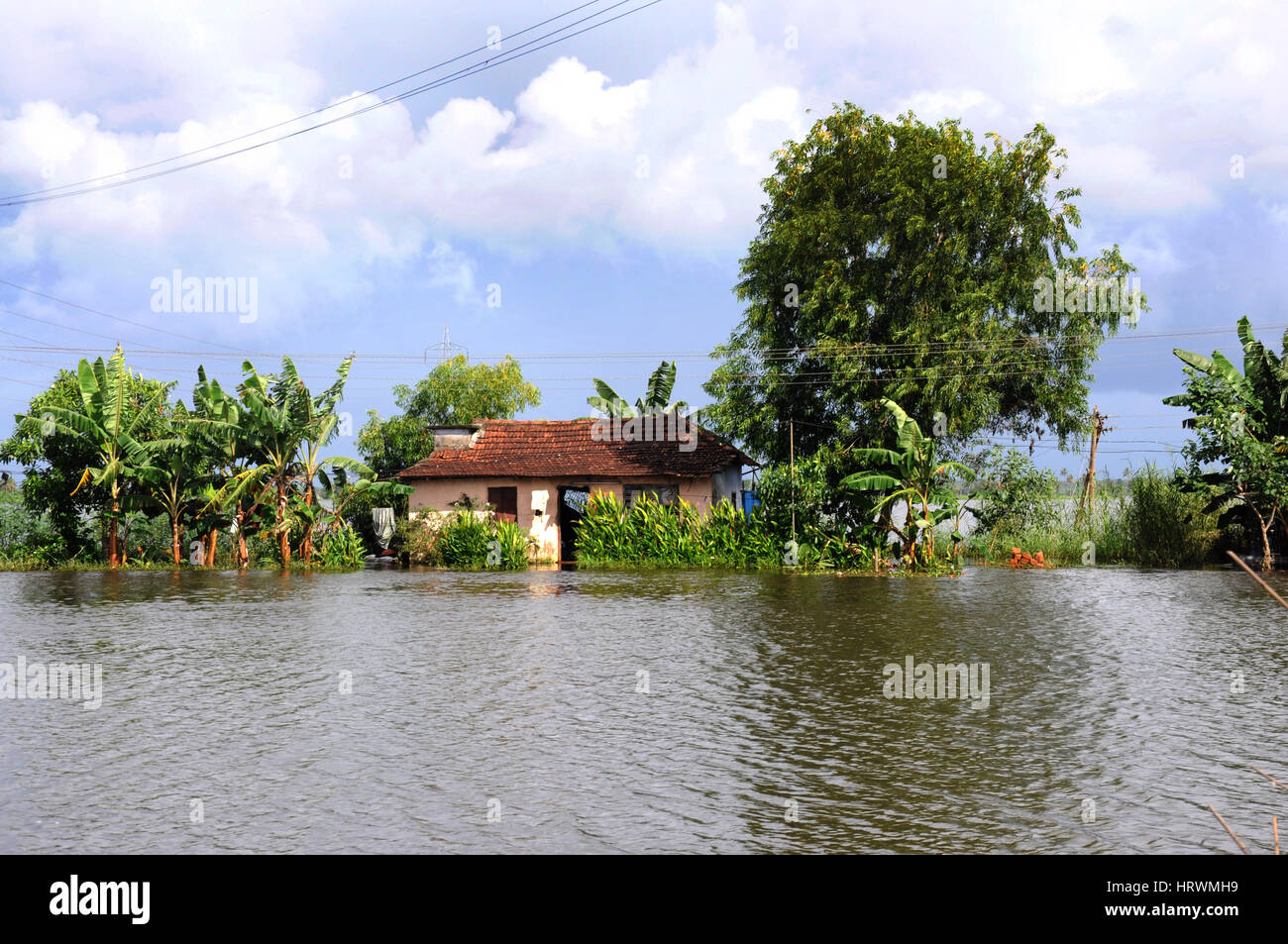 Traditional Home On The Lake In The Backwaters Near Alappuzha Stock
