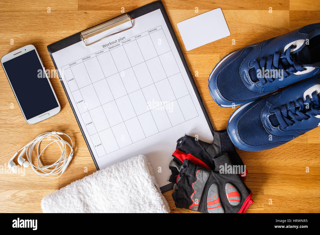 personal workout plan with phone and other stuff stock photo