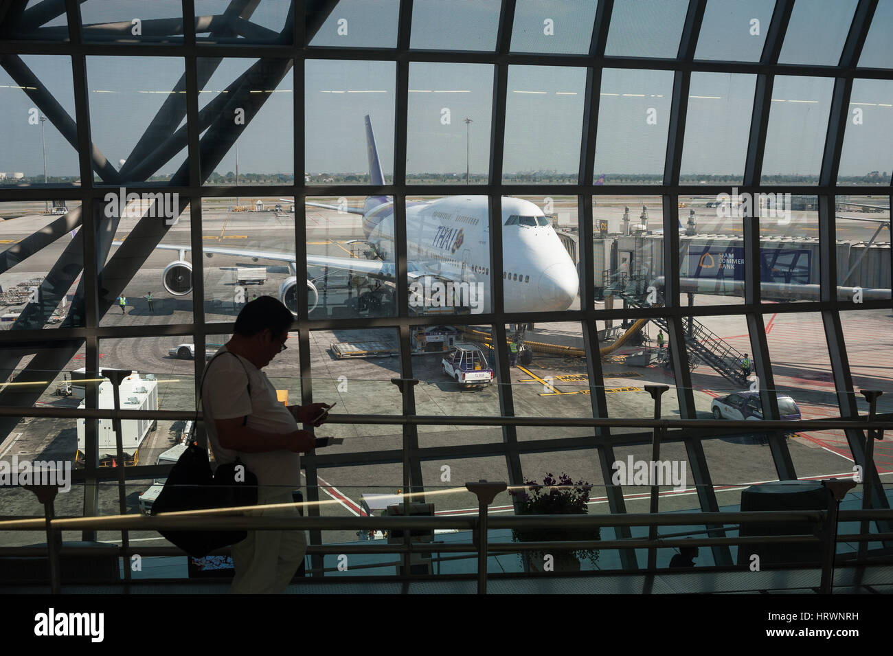 25.01.2017, Bangkok, Thailand, Asia - A Thai Airways passenger plane is parked at a gate at Bangkok's Suvarnabhumi - Stock Image