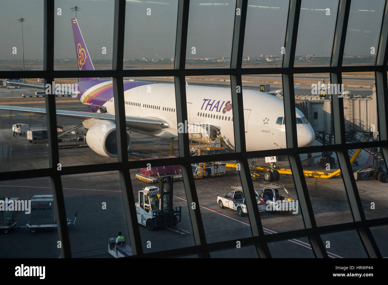 08.02.2017, Bangkok, Thailand, Asia - A Thai Airways passenger plane is parked at a gate at Bangkok's Suvarnabhumi - Stock Image