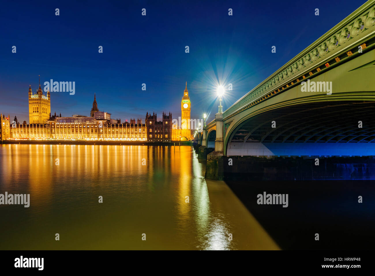View of Houses of Parliament and River Thames at night Stock Photo