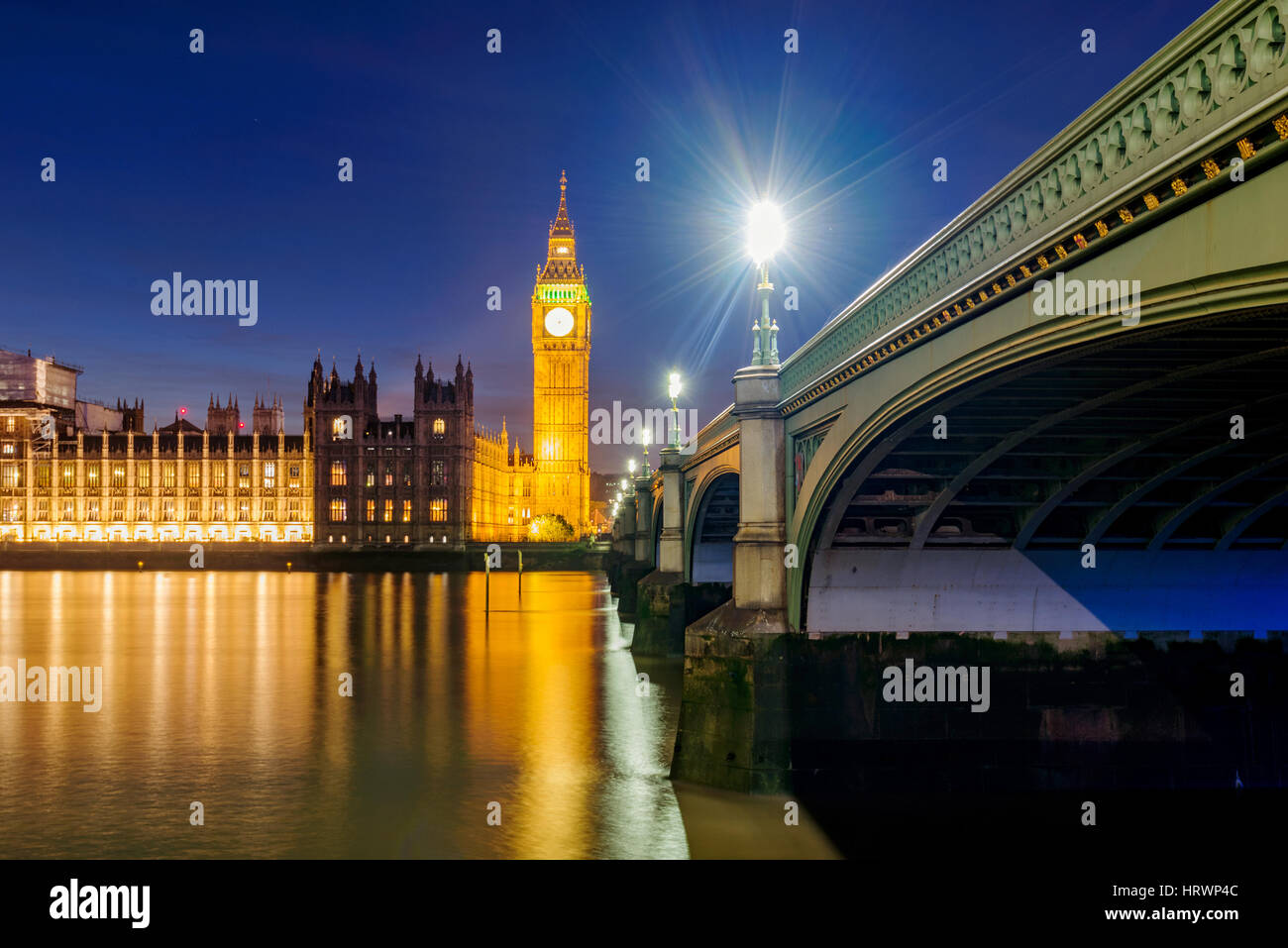 View of Houses of Parliament and River Thames at night - Stock Image