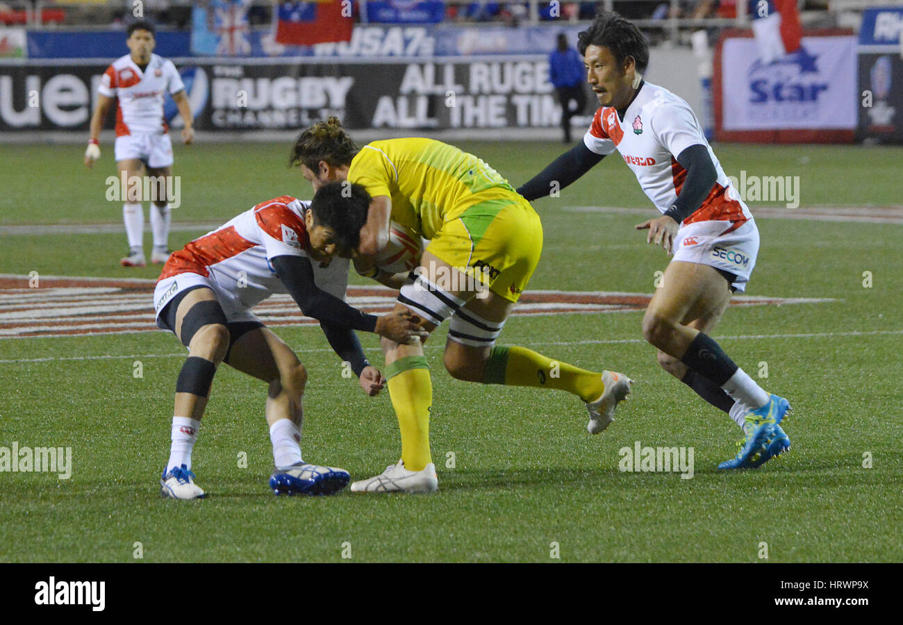 Las Vegas, Nevada, USA. 3rd Mar, 2017. Australian Rugby player Sam Myers is tackled by Japanese players during the Stock Photo