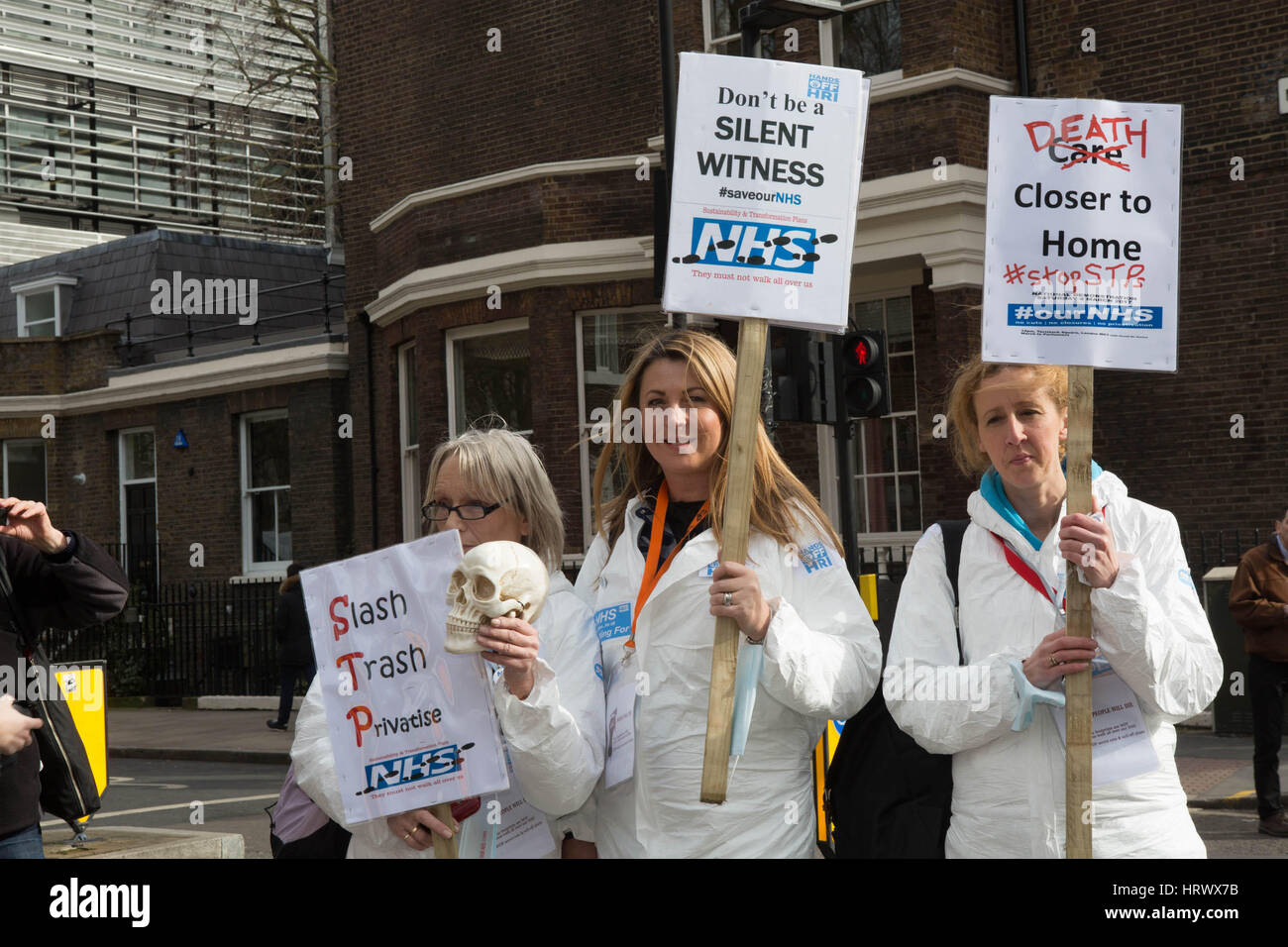 London, UK. 4th Mar, 2017. National demonstration to defend the NHS Three women with there placards Credit: Brian - Stock Image