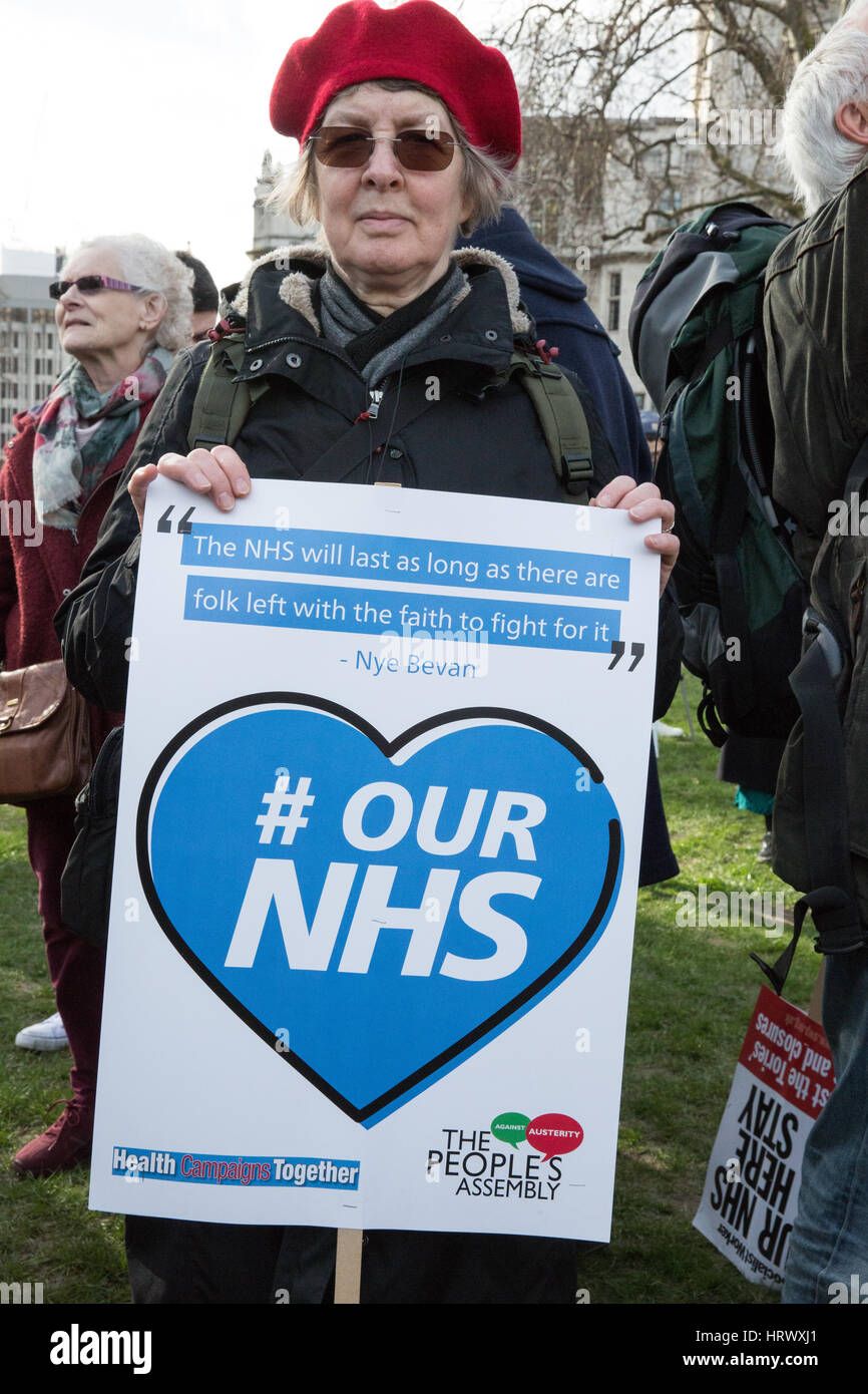 London, UK. 4th March, 2017. A supporter of the NHS takes part in the It's Our NHS national demonstration in support - Stock Image