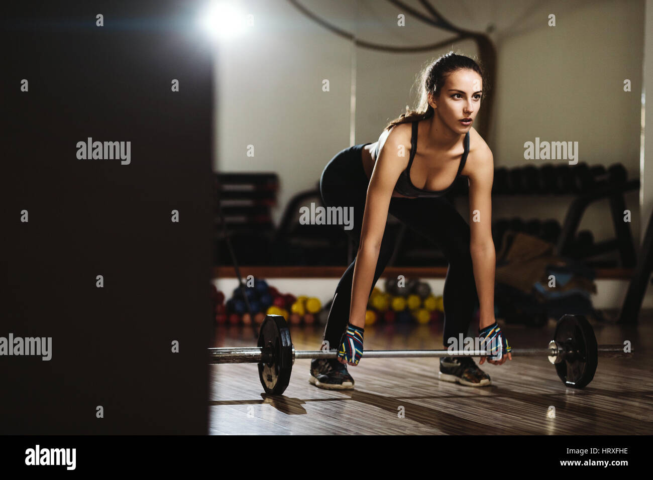 fitness woman weightlifting deadlift. Fitness model girl weightlifting in gym. - Stock Image