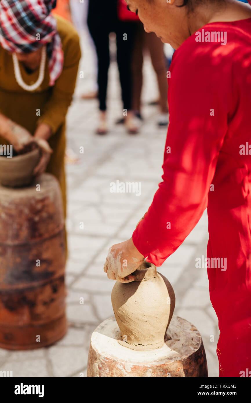 Nha Trang, VIETNAM - CIRCA February 2015 - unidentified woman creates clay pot  traditional handicraft in Vietnam Stock Photo