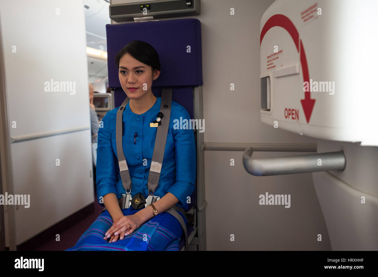 25.01.2017, Singapore, Republic of Singapore, Asia - A Thai Airways flight attendant on a flight from Singapore - Stock Image