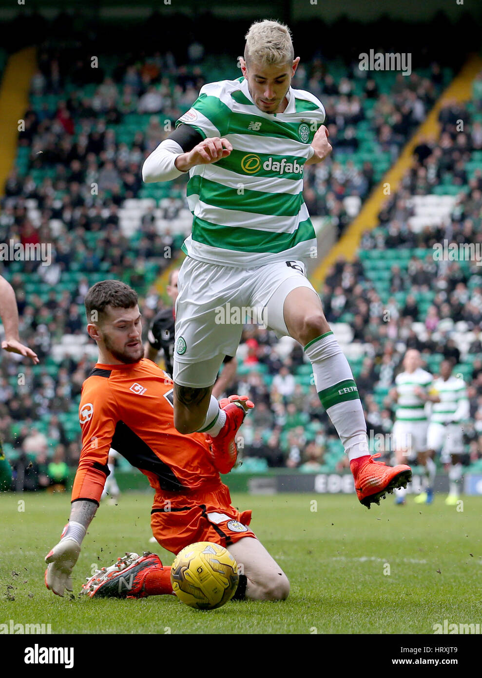 Celtic's Nir Bitton and St Mirren's keeper Billy O'Brien battle for the ball during the Active Nation - Stock Image