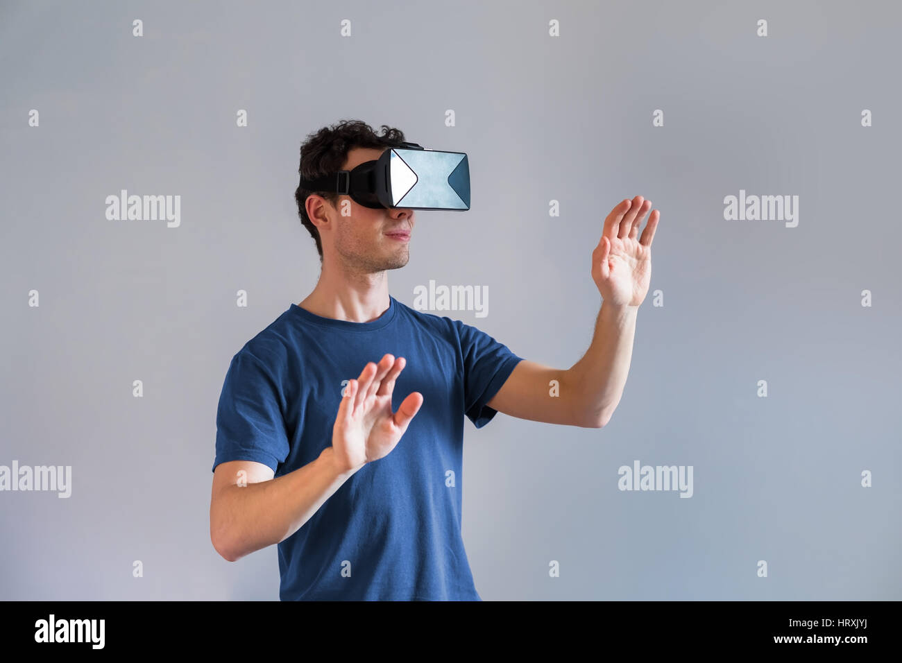 da8534d72220 Person wearing a virtual reality (VR) headset or head-mounted display (HMD)  glasses