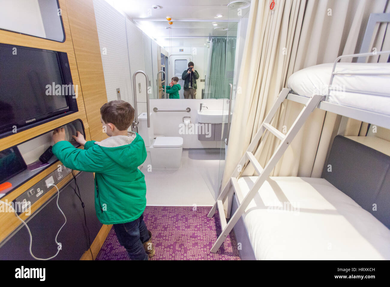 Seven year old boy at the Yotel, Gatwick airport, England, United Kingdom. - Stock Image
