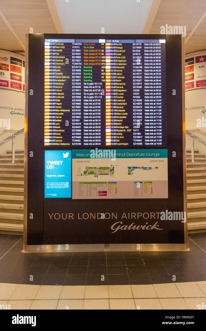 Flight information display board, London Gatwick Airport, England, United Kingdom. - Stock Image