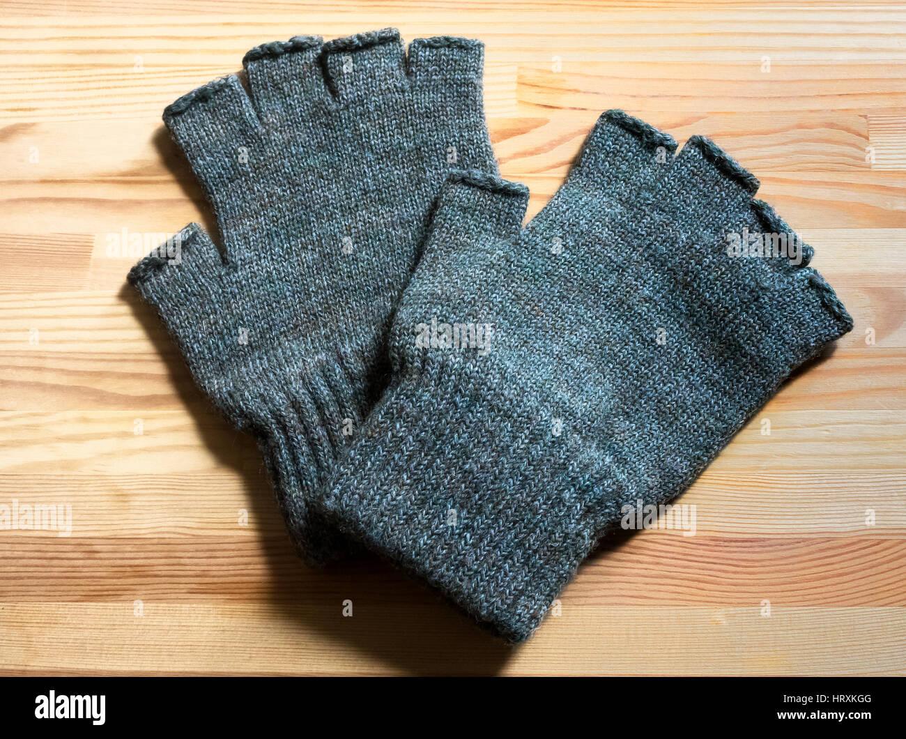 fingerless woolen gloves - Stock Image