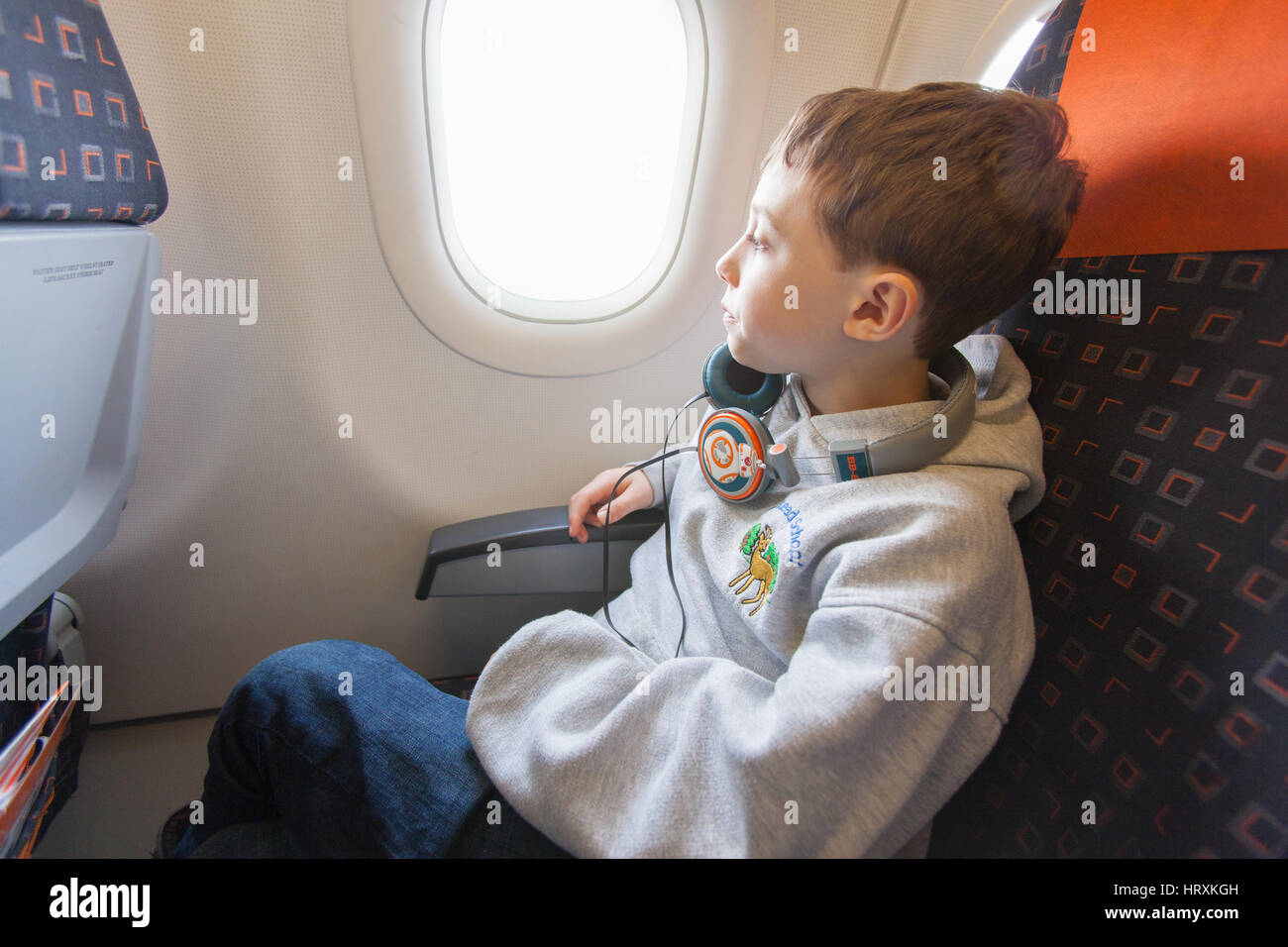 Seven year old boy on-board a easy jet flight, Gatwick airport, England, United Kingdom. - Stock Image