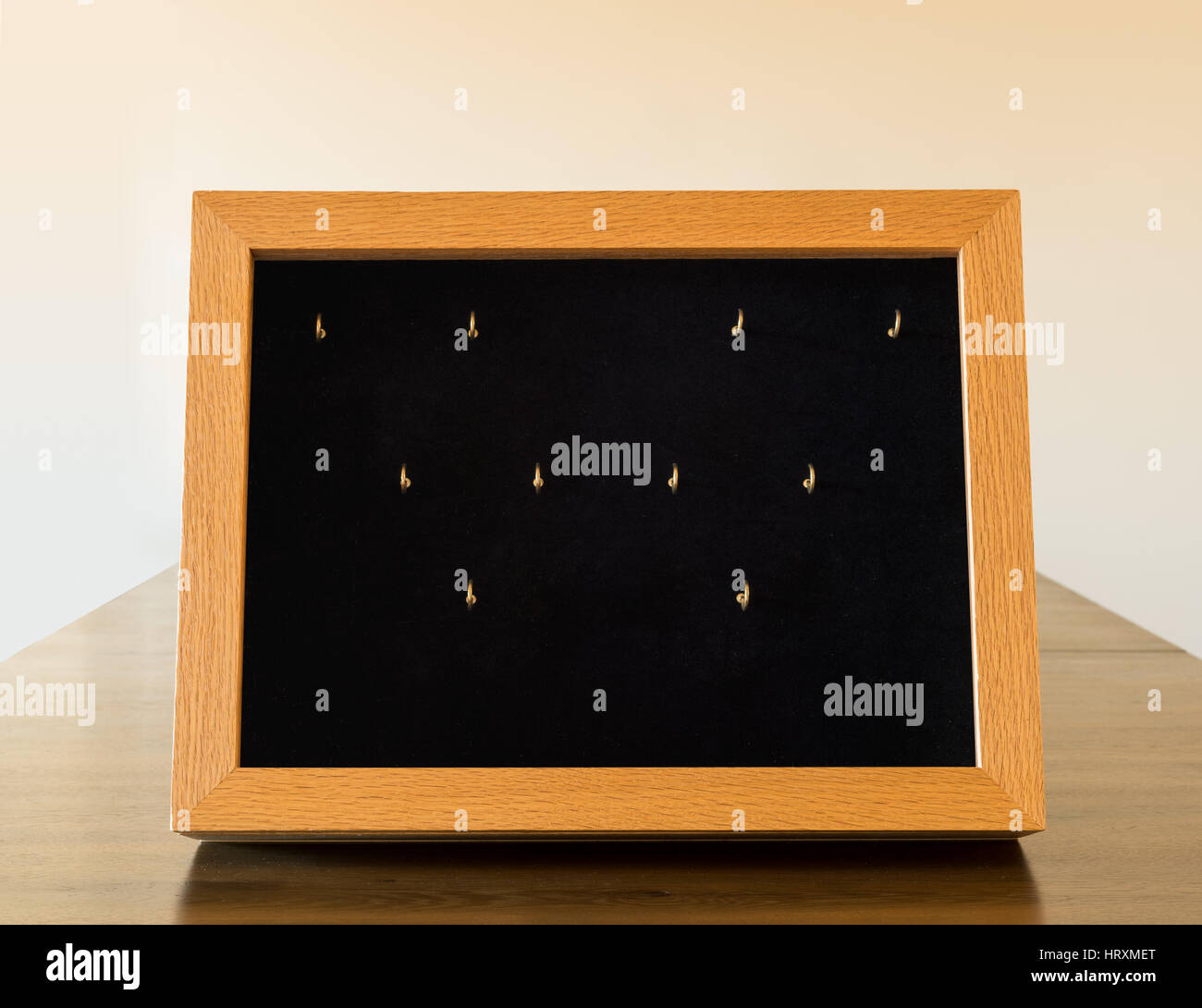 Wooden display case with glass window to show small jewelry or products in store or art fair - Stock Image