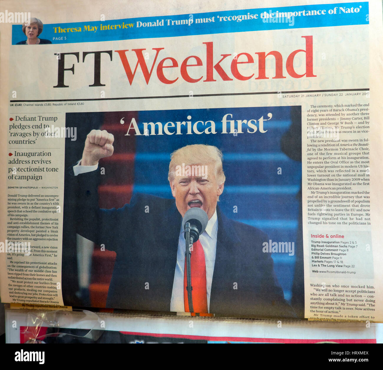 Donald Trump shaking his fist on the front page of the FT Weekend newspaper shouting  'America First'  headline - Stock Image