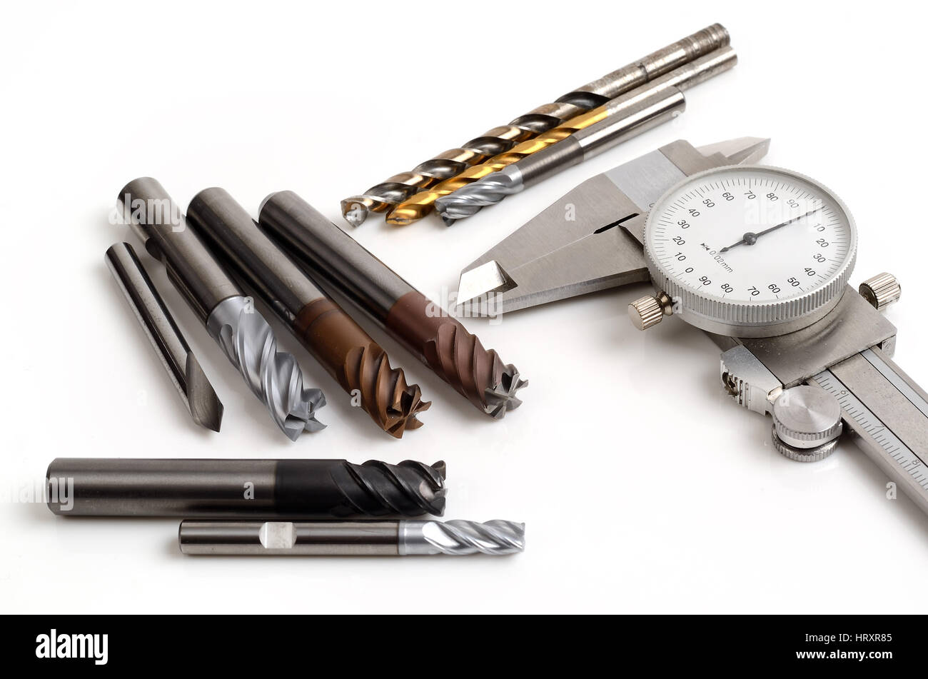 Metal milling tools for cnc machine on white background - Stock Image