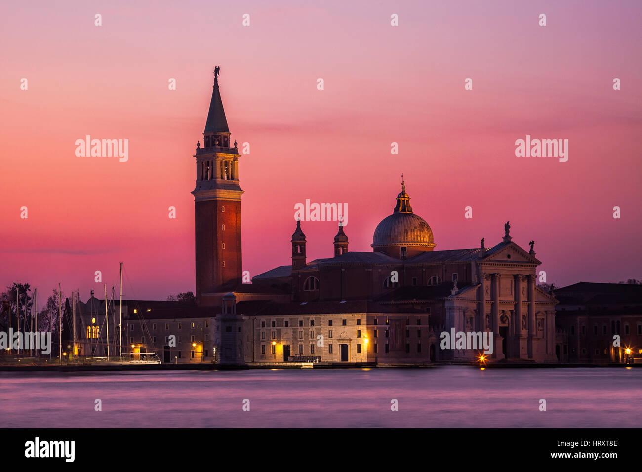 Dawn breaks over the island of San Giorgio Maggiore seen from St. Mark's Square in Venice, Italy - Stock Image