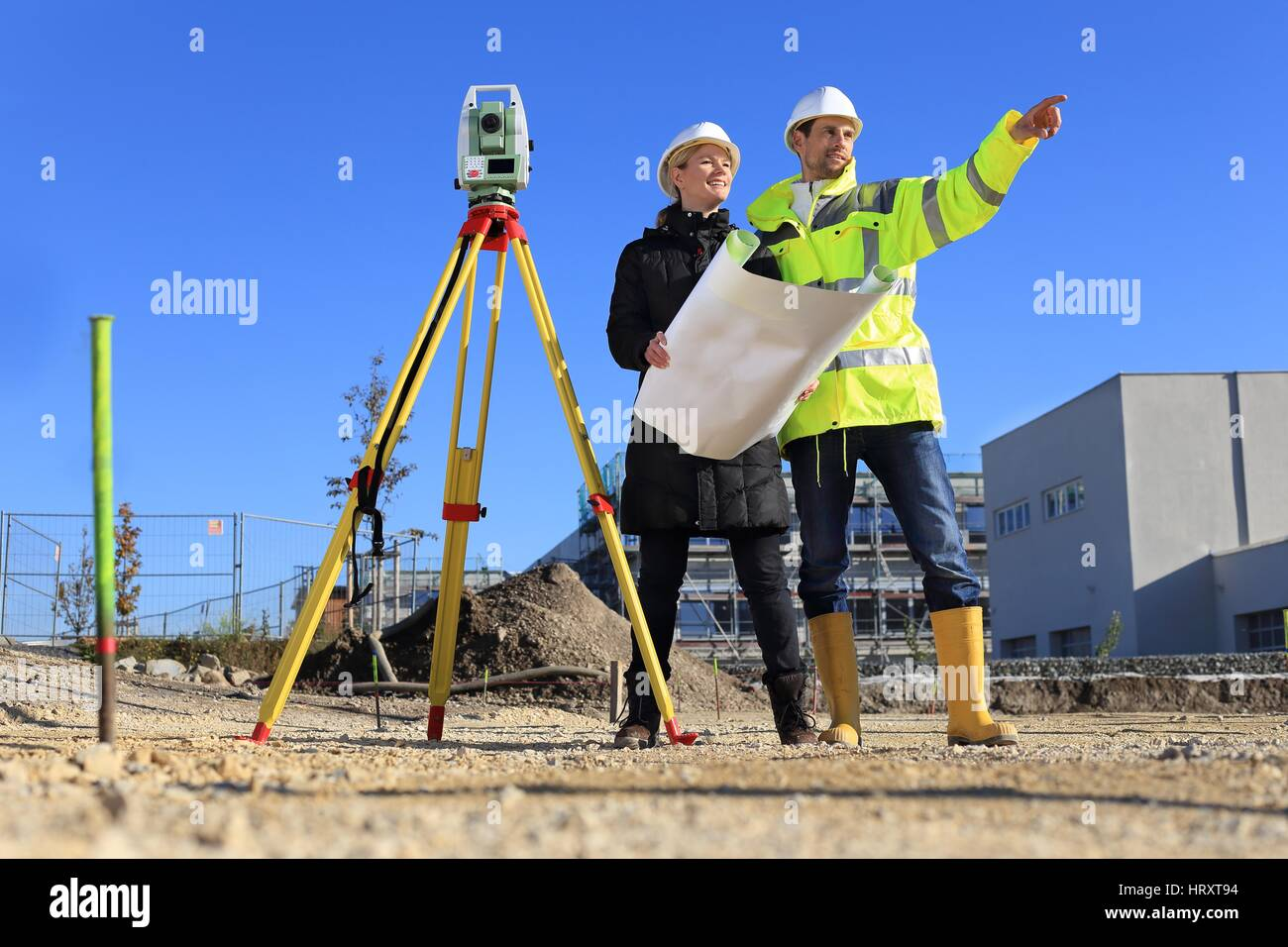 A Female Architect and surveyor on a construction site - Stock Image