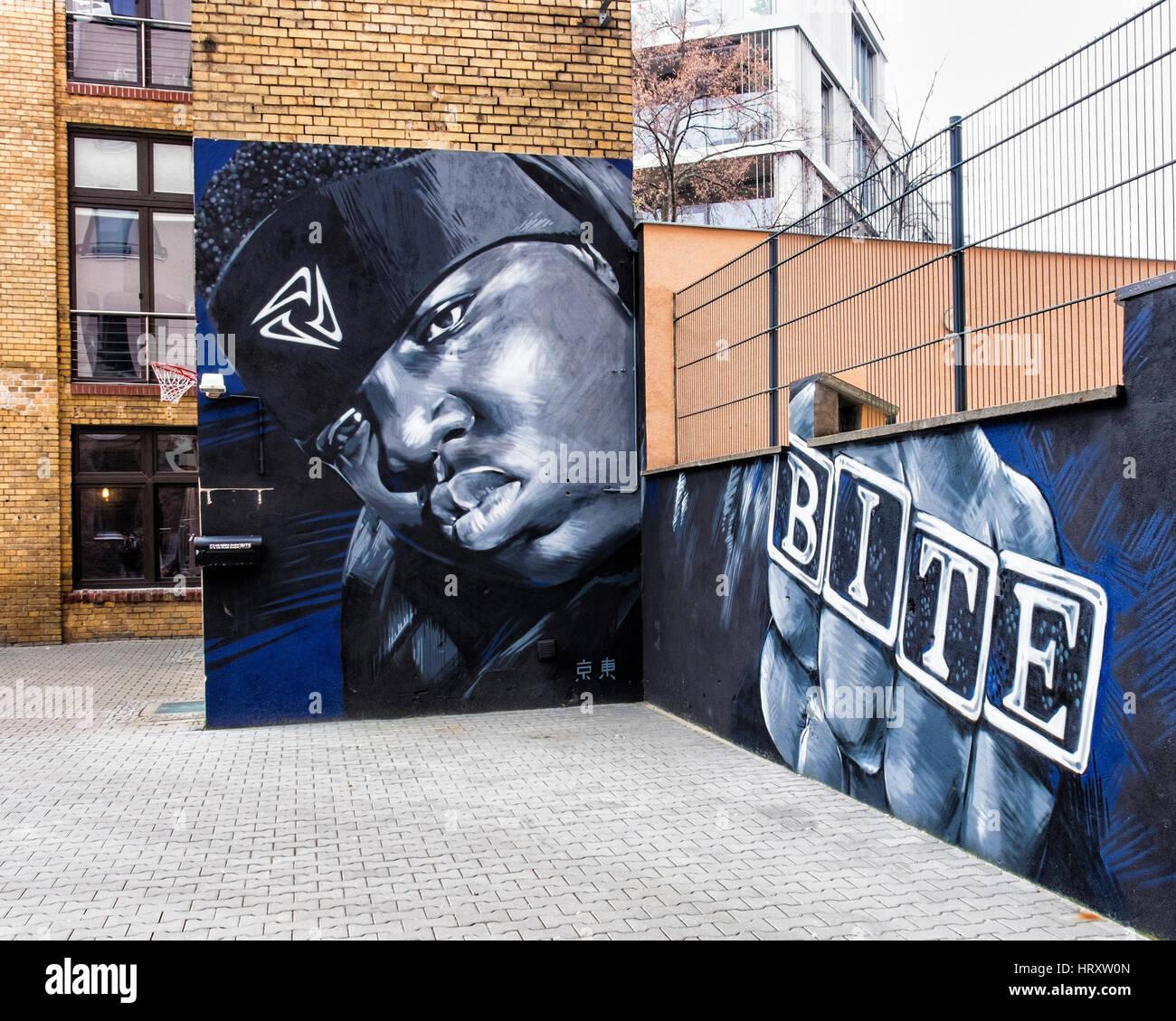 Berlin, Prenzlauer Berg. Mural artwork of black man outside Bite talent management agency in building courtyard Stock Photo