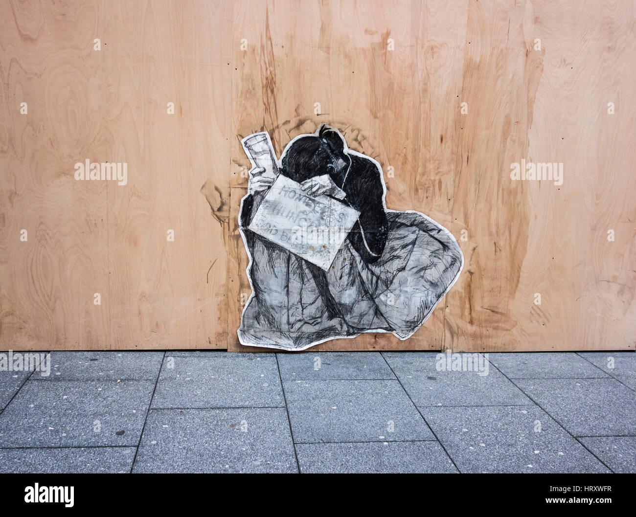 Artwork on a hoarding.Depicting homelessness. - Stock Image
