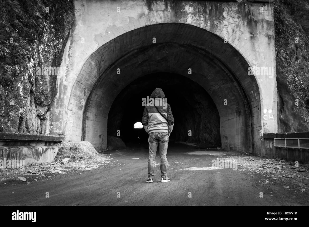 Man entry in a tunnel - Stock Image