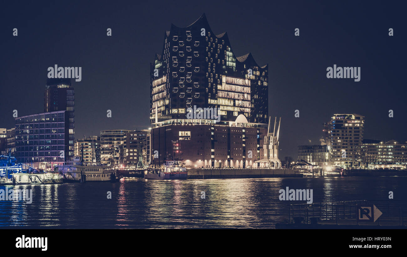 Panorama of the Elbphilharmonie of Hamburg at night, with the view on to both sides of the building, the lake elbe - Stock Image