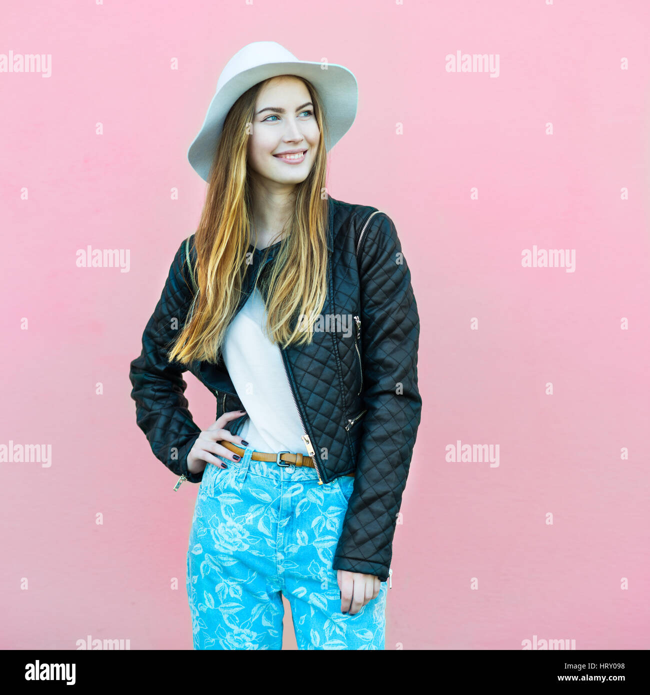 Young Happy Fashion Blogger Girl Posing Near The Wall