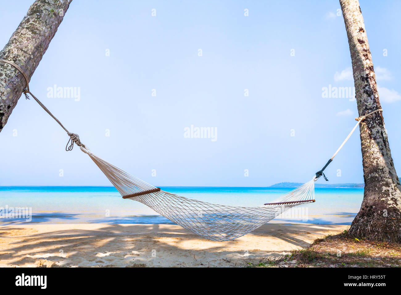 beach holidays on tropical island, beautiful hammock in hotel, relaxation concept background - Stock Image