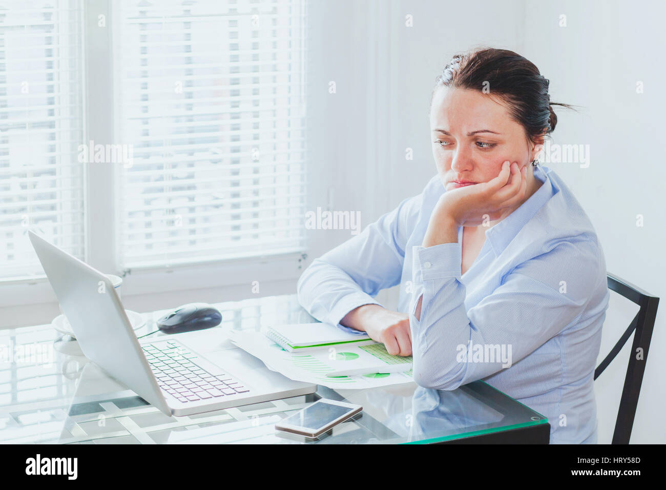 doubt concept, difficult job, business woman in front of complex project with big responsibility, scared uncertain - Stock Image