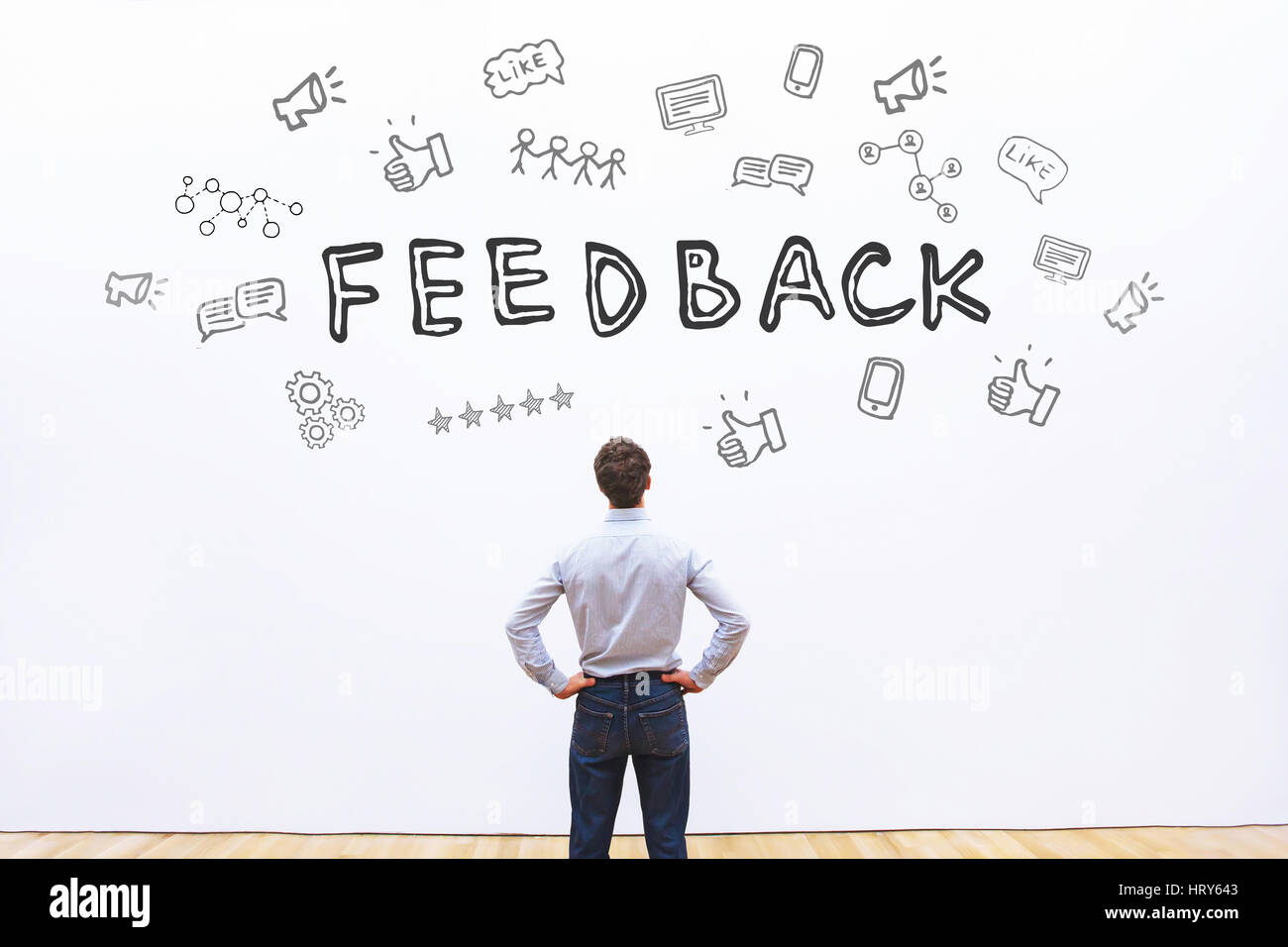 feedback concept, business man looking at the drawn sketch with icons - Stock Image