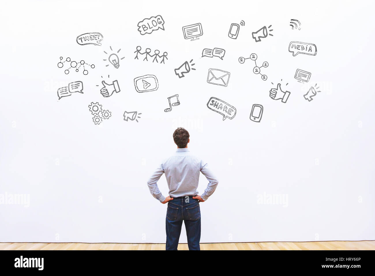 social media or network concept background, man looking at the icons of tweet, share, like and blog - Stock Image