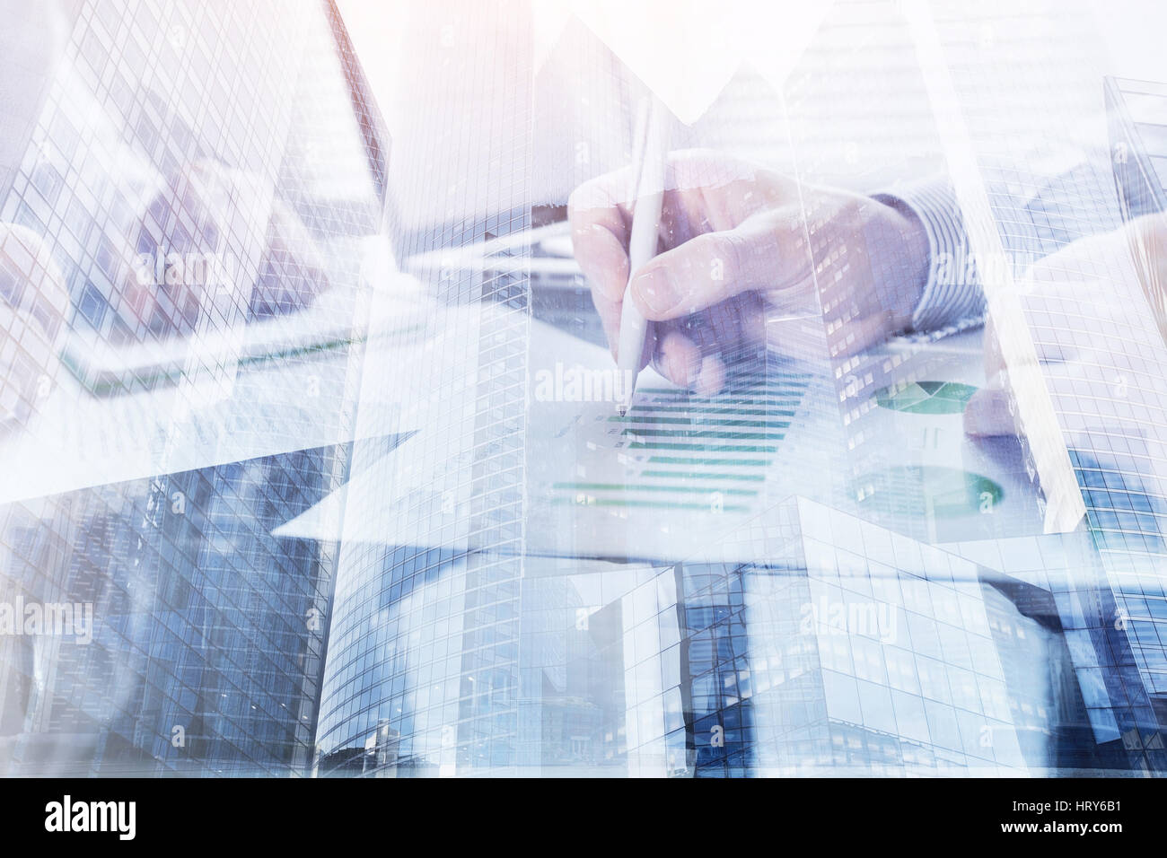business people working in the office, double exposure of hands closeup, monitoring and analytics - Stock Image