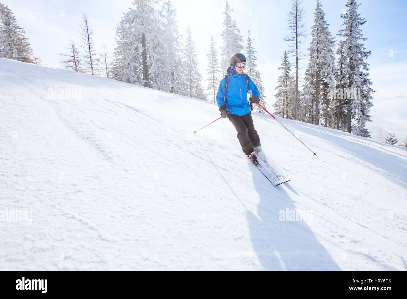 downhill skiing background, skier in mountains, winter sport - Stock Image