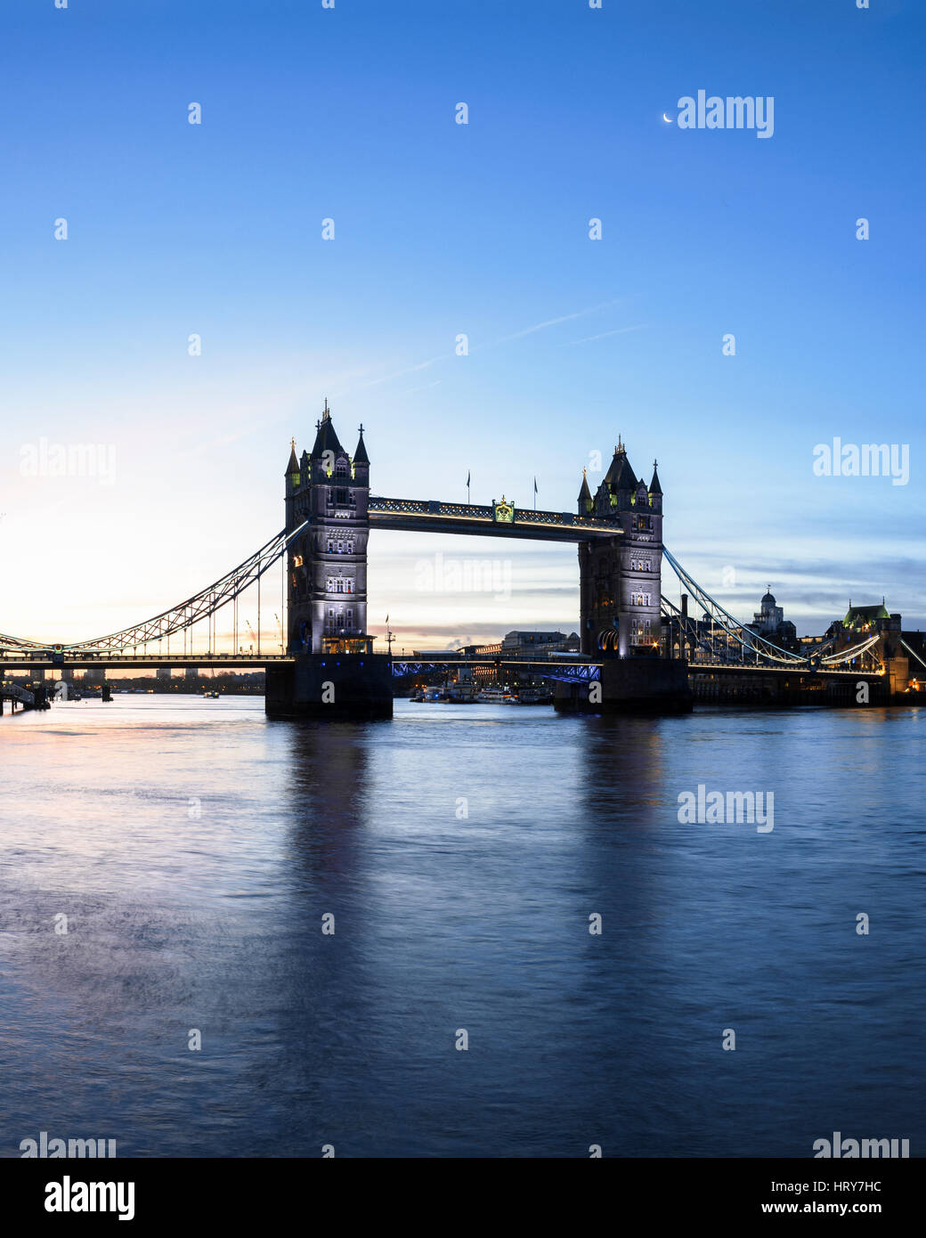 Tower Bridge and River Thames illuminated at twilight, London, UK - Stock Image