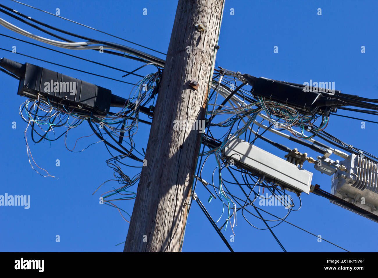 Telephone Terminals in Disarray on Phone Pole I - Stock Image