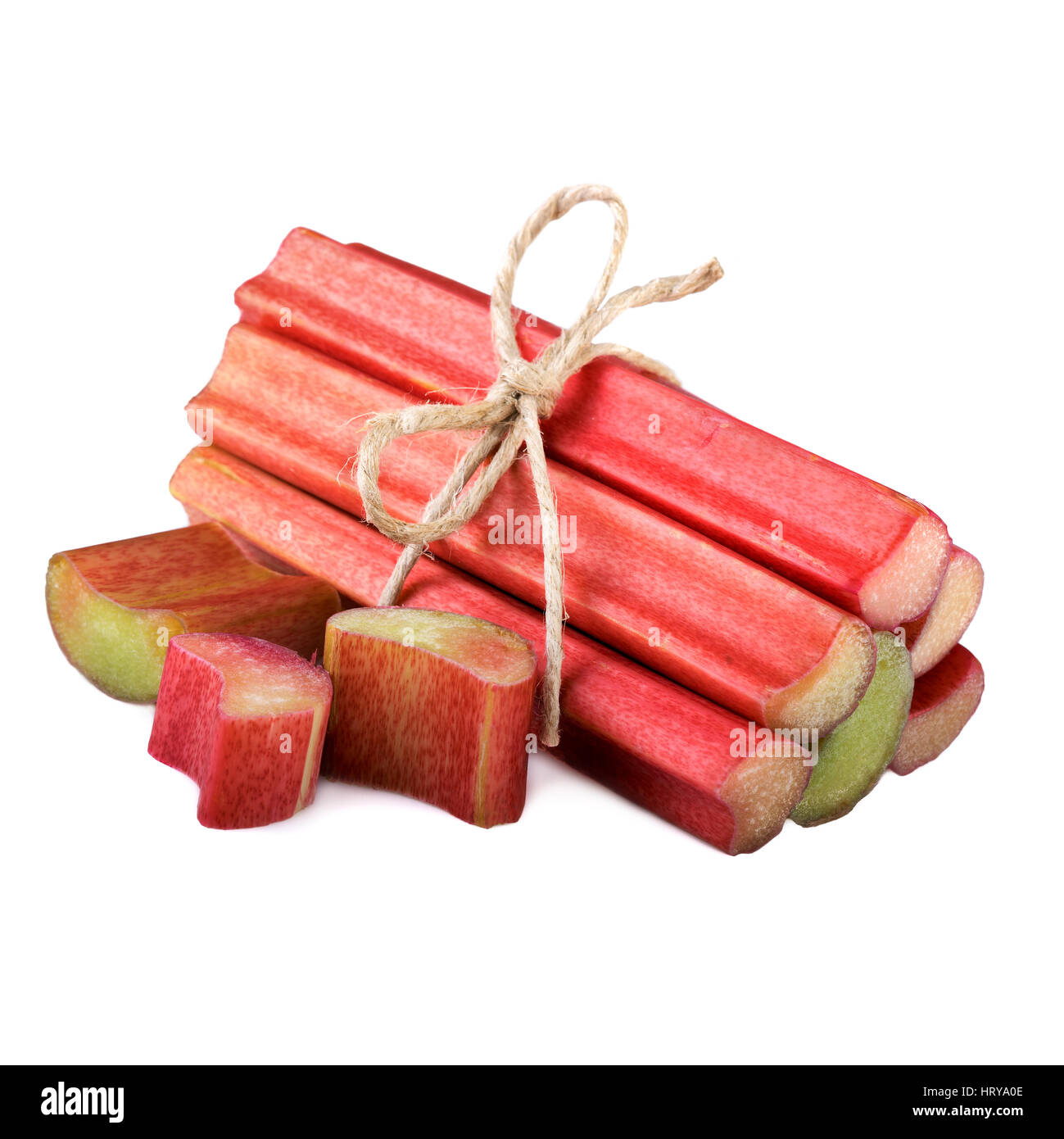 fresh rhubarb pieces sour vegetables on white - Stock Image