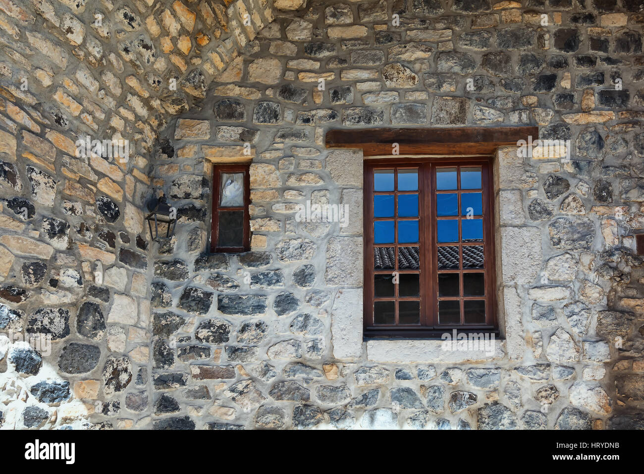 Large and small window in an old basalt wall. - Stock Image