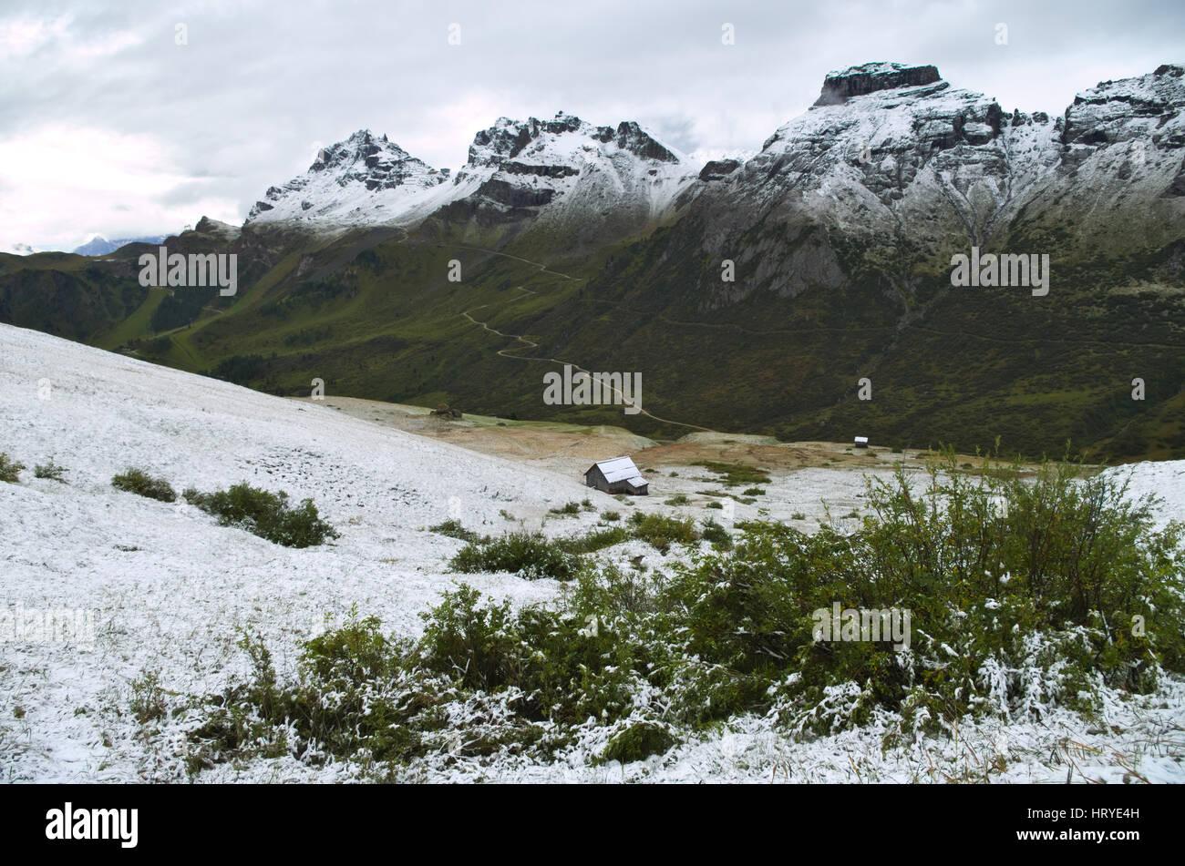 Passo Pordoi: first snow of the season on the Dolomiti mountains, Italy Stock Photo