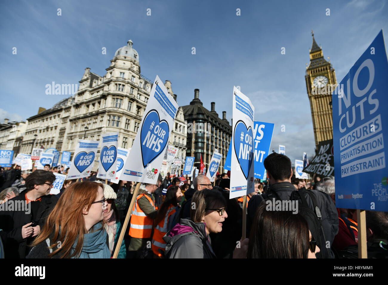 London, UK.  4th Mar, 2017. Protesters march past Parliament during a demonstration in support of the NHS. Thousands - Stock Image