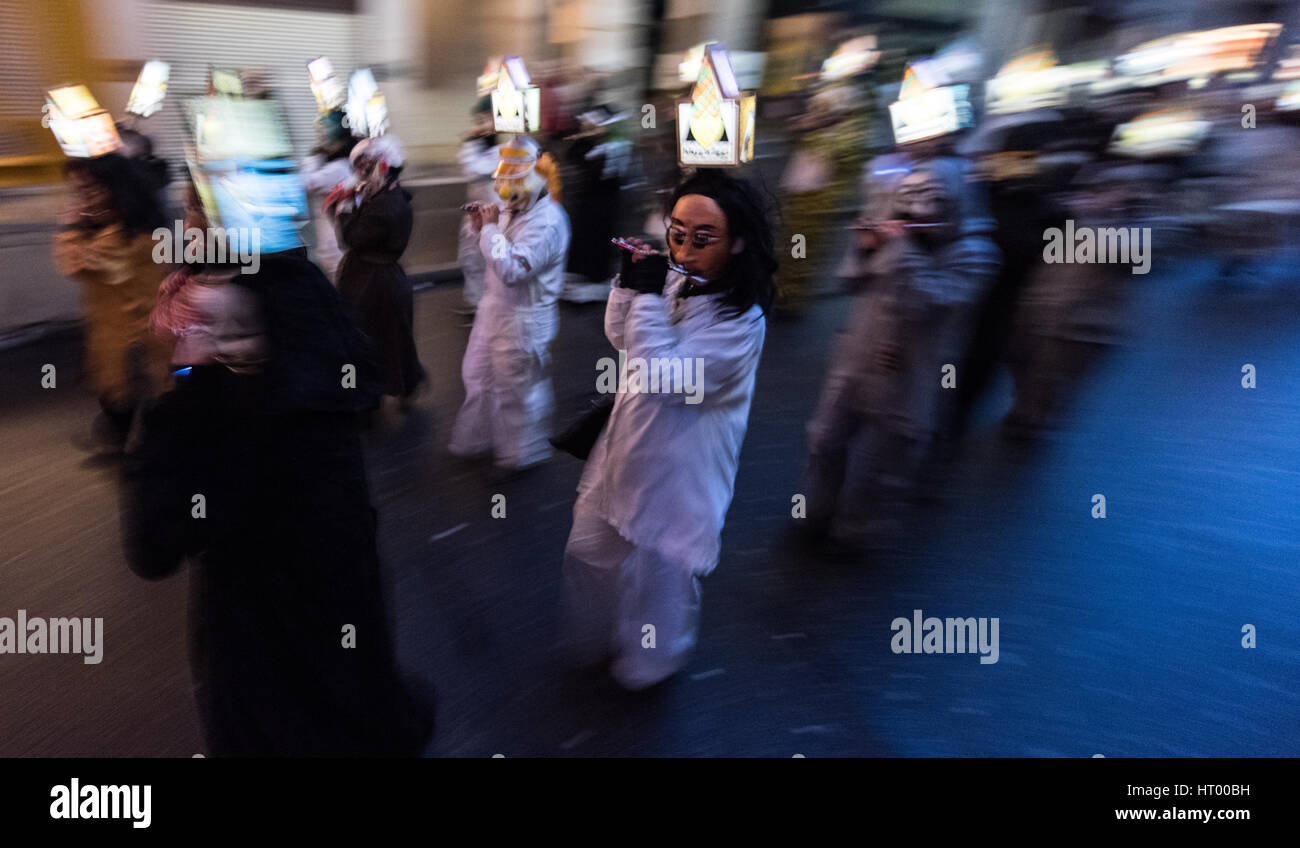 Basel, Switzerland. 6th Mar, 2017. Fools playing instruments parade through the narrow streets of Basel, Switzerland, Stock Photo