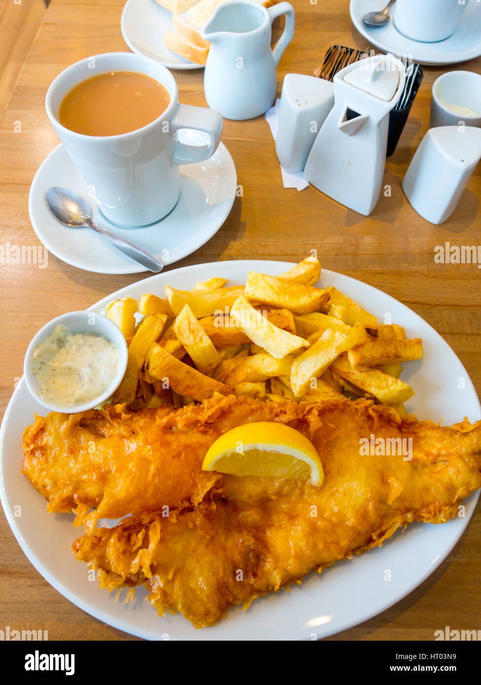 Excellent fish and chips, with bread and butter tartare sauce and a mug of tea  at Oliver's famous fish restaurant - Stock Image