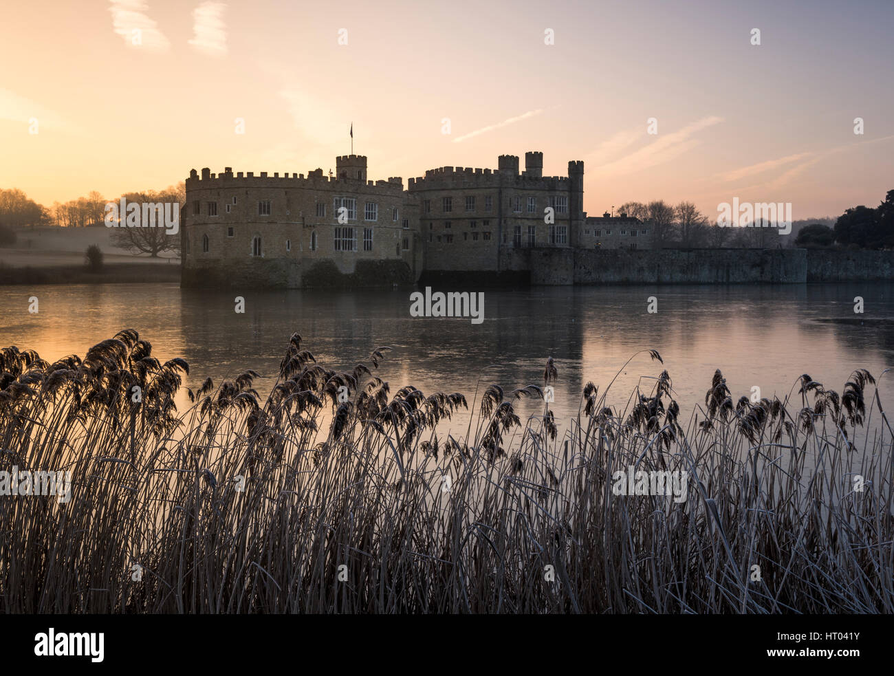 Colourful sunrise at Leeds Castle, Kent on a Winter's morning. - Stock Image