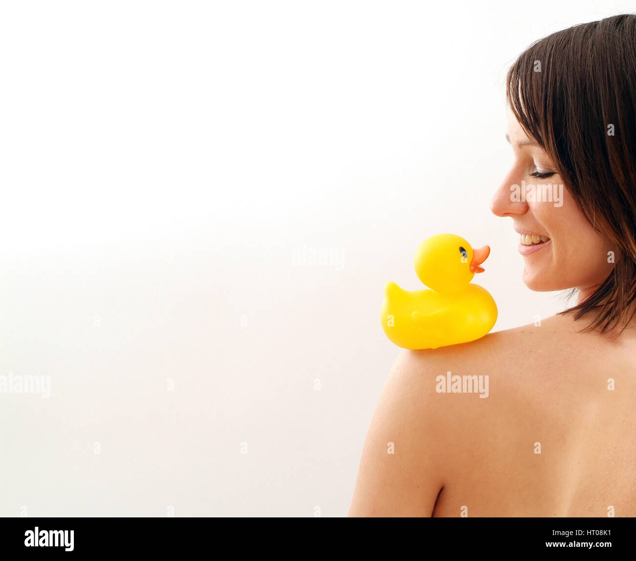 Junge Frau mit Badeente auf der Schulter - young woman with rubber duck on shoulder Stock Photo