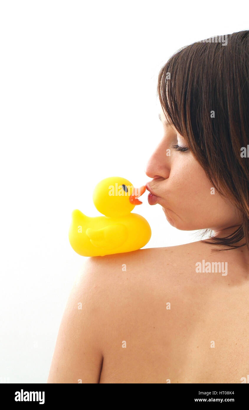 Junge Frau kuesst Badeente - young woman kissing rubber duck Stock Photo