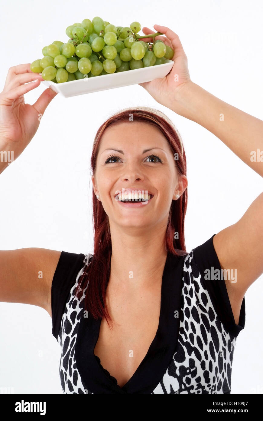 Junge Frau mit Weintrauben - young woman with grapes - Stock Image