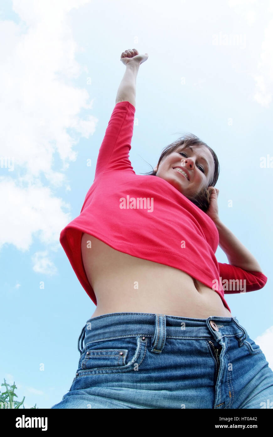 Junge Frau voll Lebensfreude - young woman full of life - Stock Image