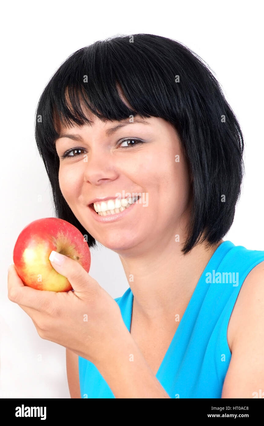 Frau isst Apfel - woman eats apple - Stock Image