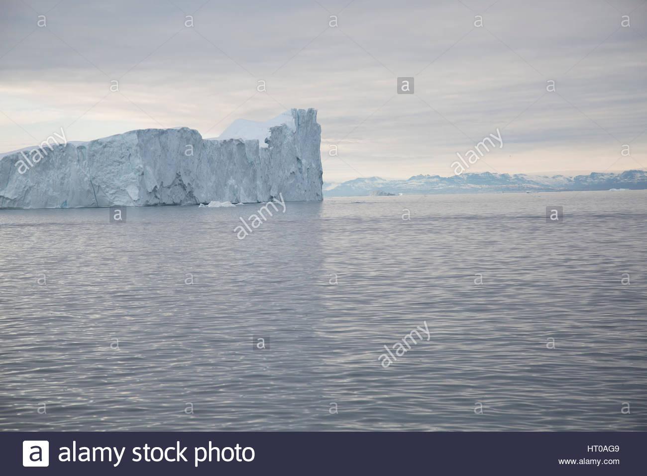 Sea of Iceberg Greenland Overcast Distant Disko Bay - Stock Image